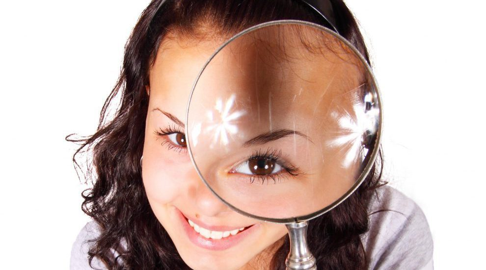 Female with a magnifying glass