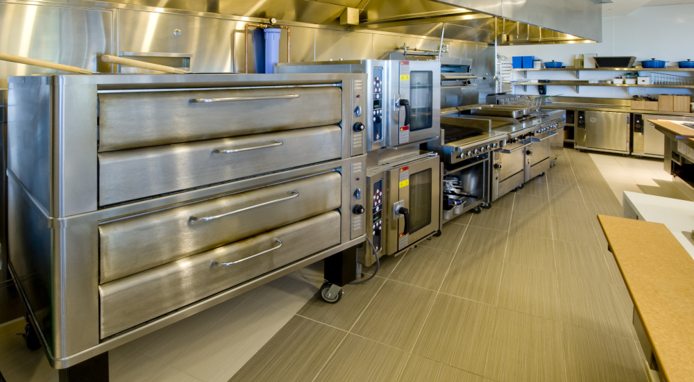 Image of a commercial kitchen with a pizza oven