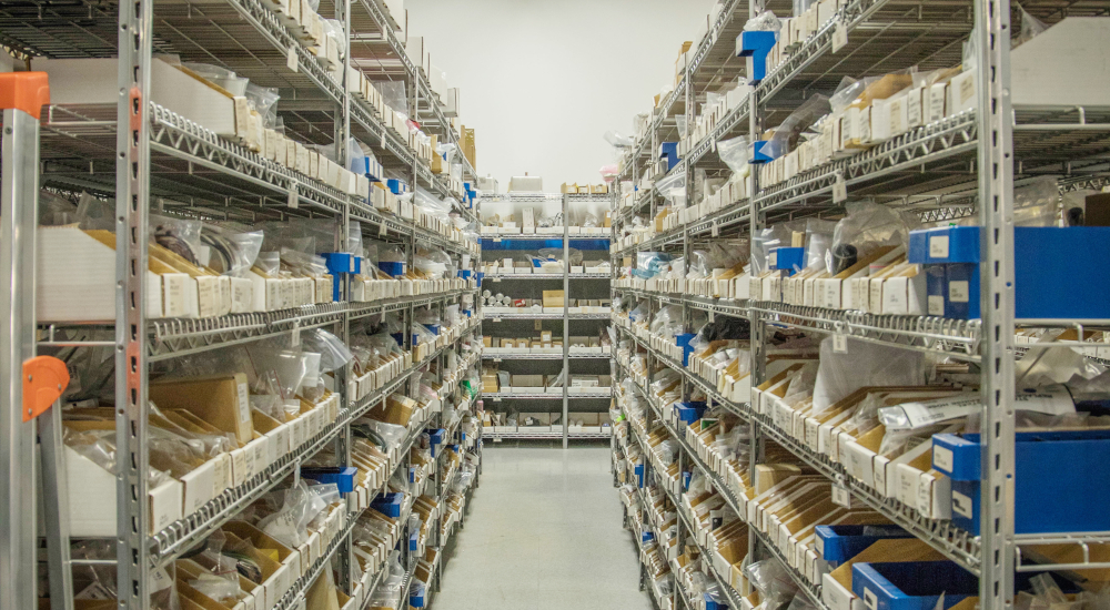 Shelving of OEM replacement parts in our warehouse