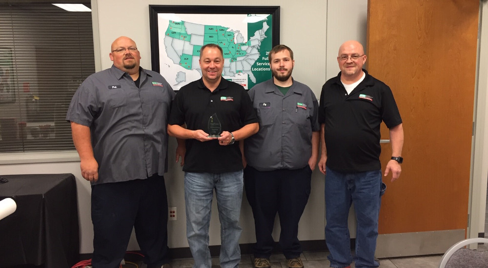 General Parts Group's President, Gary Shermann, and team receiving award from Alto-Shaam