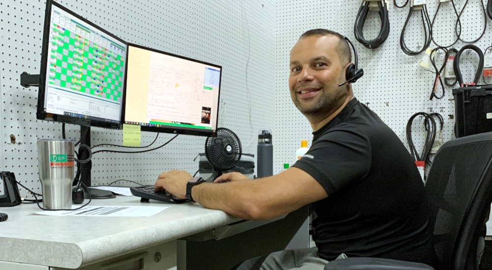 A General Parts Group's Service Support Specialist at his desk